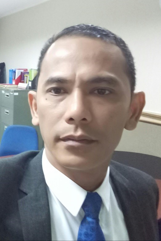 Dr. Iskandar Muda, S.H., M.H.